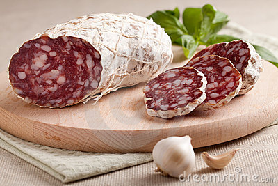 Traditional sliced salami with garlic and herbs