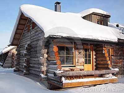 Traditional snow covered log cabin