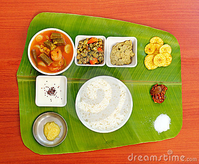 Traditional southern-indian lunch on banana leaf