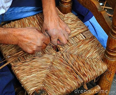 Traditional spain reed chair handcraft man hands