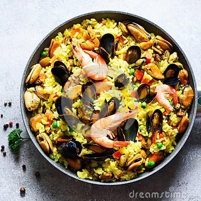 Free Traditional Spanish Seafood Paella In Pan Rice, Peas, Shrimps, Mussels, Squid On Light Grey Concrete Background. Top Stock Image - 114392761