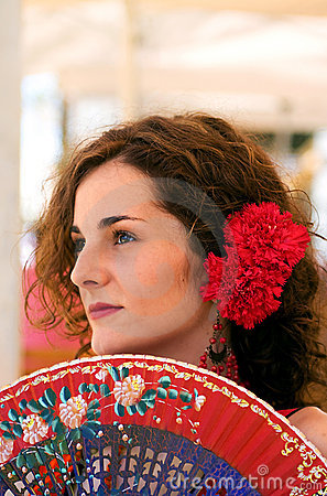 Traditional Spanish Woman with Red Fan