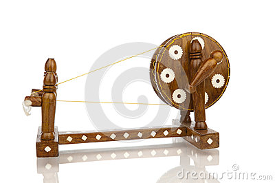 Traditional spinning wheel isolated in white