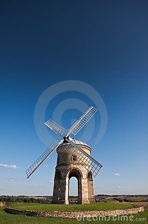Traditional stone windmill under blue skies
