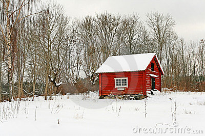 Traditional Swedish red wooden house in snow