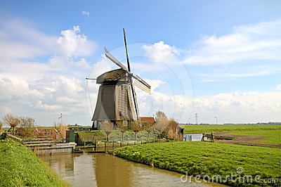 Traditional windmills in dutch landscape