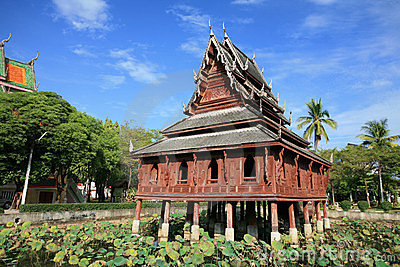 Traditional wooden chedi on the lotus pond