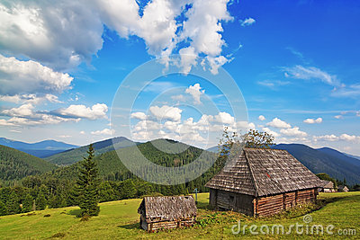Traditional wooden house in the mountains and forest.