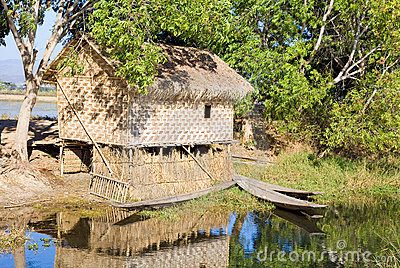Traditional wooden stilt house and canoe