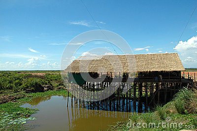 A Traditional Wooden/Thatch House on water