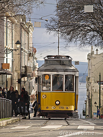 Traditional yellow trams in Lisbon Editorial Image