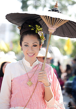 Traditionally dressed girl in procession Editorial Stock Photo
