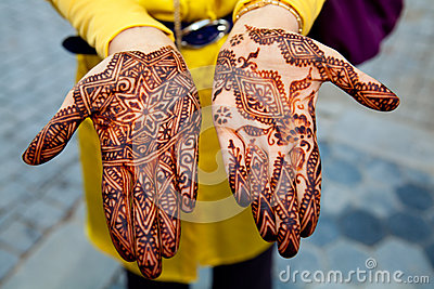 Traditionally henna painted hands