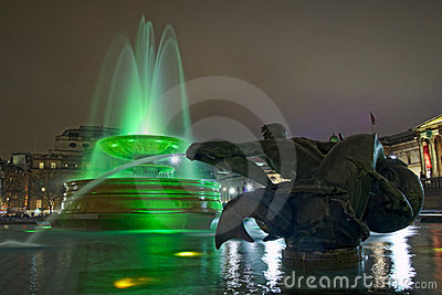 Trafalgar square in London, fountain at night