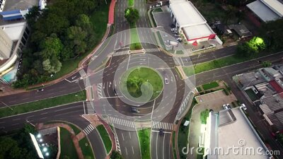 Traffic of cars on a roundabout at night stock footage
