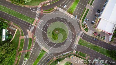 Traffic of cars on a roundabout stock video footage