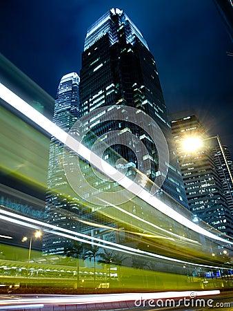 Traffic in Commercial Landmark at Night