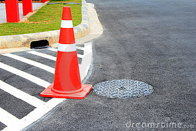 Traffic cone on traffic marking.