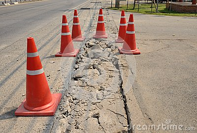 Traffic cone  used on concrete pavement .