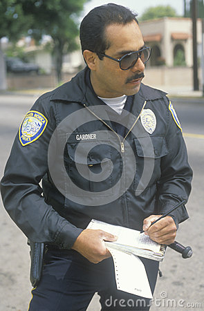 Traffic cop writing ticket, Editorial Photography