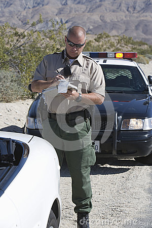 Traffic Cop Writing Ticket