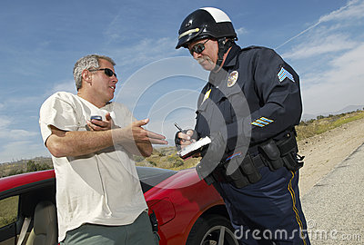 Traffic Cop Writing A Ticket