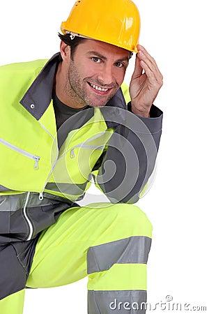 Traffic guard touching his hard hat