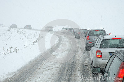 Traffic jam in heavy snowfall on mountain road Editorial Photo