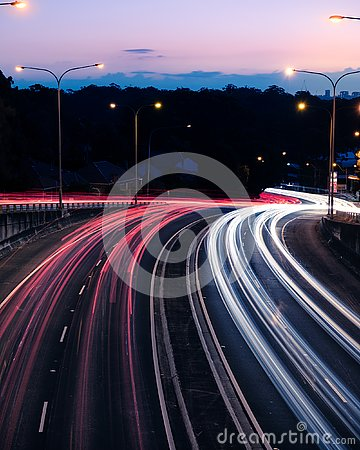 Traffic light trails at dusk down Ryde Road, seen from the Pacific Highway Bridge at Pymble - portrait Editorial Stock Photo