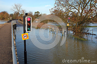 Traffic lights on a flooded road.