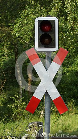 Traffic sign on the iron railroad crossing
