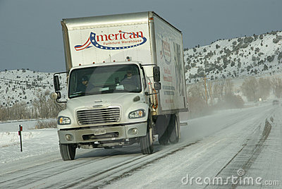 Traffic speeds along icy and snowy roads Editorial Photography