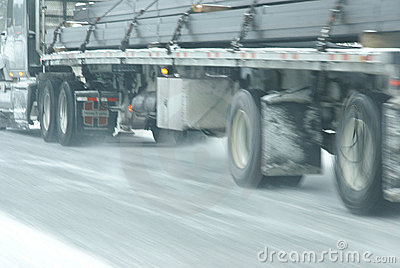 Traffic speeds along icy and snowy roads Editorial Image