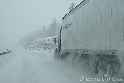 Traffic speeds along icy and snowy roads Editorial Photo