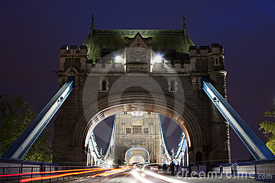 Traffic on The Tower Bridge at night in London, UK