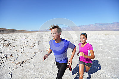 Trail running marathon athletes outdoors in desert