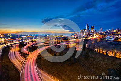 Trailing Car Lights and the Seattle Skyline at Sunset