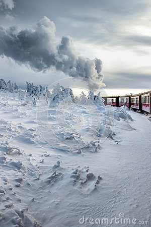 Free Train Arriving At The Top Of The Mountain Royalty Free Stock Image - 140088976