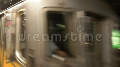 Train arriving at dekalb Ave Station in the Ny Subway System. A train arrives at dekalb Ave Station in the subway system in new york stock footage