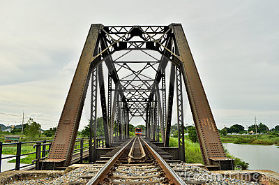 A train crossing the iron bridge