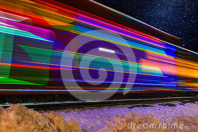 Train Decorated with Holiday Lights Blurs Past