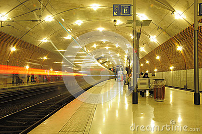Train departs from the station. Editorial Stock Image