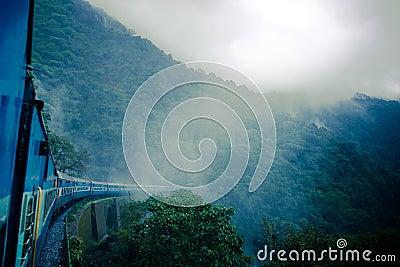 Train between haze and rain