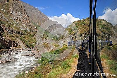 Train from Ollantaytambo goes to Machu Picchu. Editorial Stock Image
