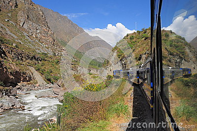 Train from Ollantaytambo goes to Machu Picchu pueblo. Editorial Stock Photo