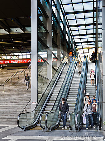 Train passengers using escalators. Editorial Photo