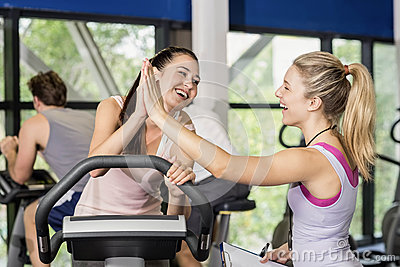 Trainer woman and sportswoman high-fiving Stock Photo