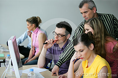 Trainer with young adults in a conference room