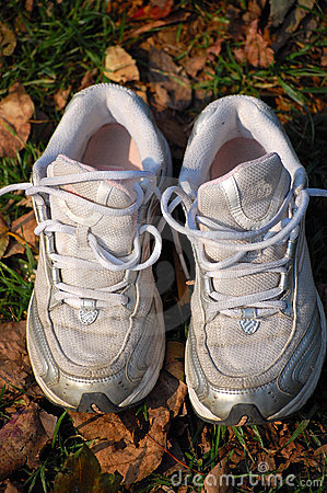 Trainers on autumn leaves