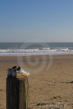 Trainers on groyne overlooking sea